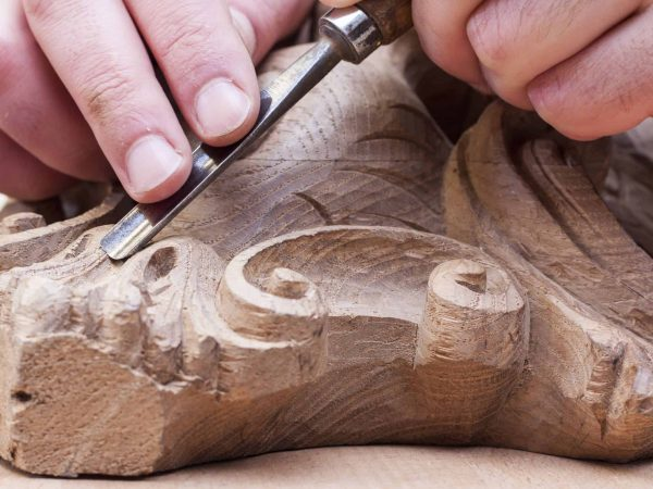 16839237 – craftsman carving with a gouge